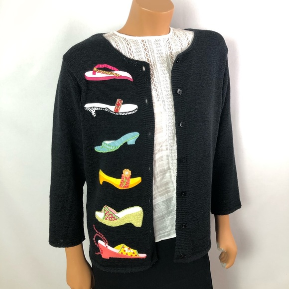 Black knitted cardigan decorated with beaded shoes